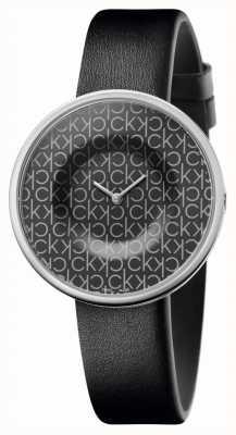 Calvin Klein | Frauen | Manie | schwarzes Lederband | schwarzes ck Muster Zifferblatt | KAG231CX